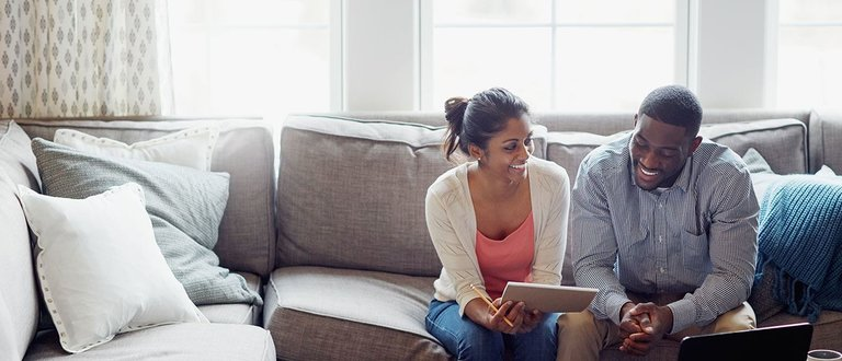 couple reviewing bill with laptop
